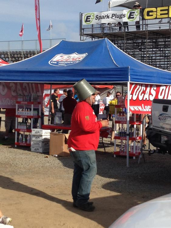 …And we thought the beer box hat was funny. But a bucket works, too.