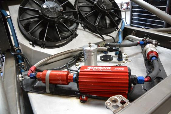 An Aeromotive fuel system provides a steady flow of fuel to the Ford V-8 come race time. The fuel system is mounted high and in an easily accessible position on top of the fuel cell, should something need to be changed out quickly.